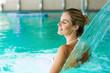 Leinwanddruck Bild - Portrait of beautiful woman relaxing in swimming pool