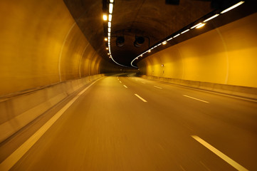 Empty highway road at night tunnel with speed motion blur