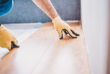 A man worker lays laminate - professional construction and finishing services