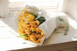 beautiful bouquet of yellow tulips in paper packaging