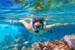 Leinwanddruck Bild - Young woman at snorkeling in the tropical water