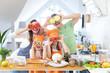 Leinwandbild Motiv Family cooking in the kitchen at home