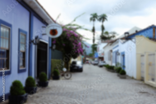 fototapeta na ścianę Urban unfocused background of the village emply cosy street. Vintage filter blur background