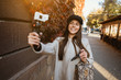 Leinwanddruck Bild - Cute, young female blogger posing on camera.