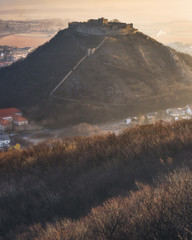 Ruin of the Castle on the Hill at Sunrise. Schlossberg Castle in Hainburg an der Donau, Austria at Sunrise as Seen from Hundsheimer Hill. © kaycco