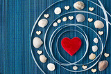 A concept of solar system with red heart in the middle and shells and small wooden hearts around it - text space - 257846042