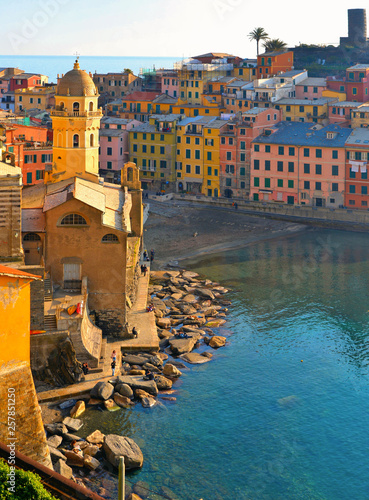 Vernazza village with typical colorful multicolored buildings houses, Castello Doria castle on rock, Ligurian Sea in background, National park Cinque Terre, La Spezia, Liguria, Italy - 257851250