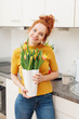 Beautiful woman with tulips in vase