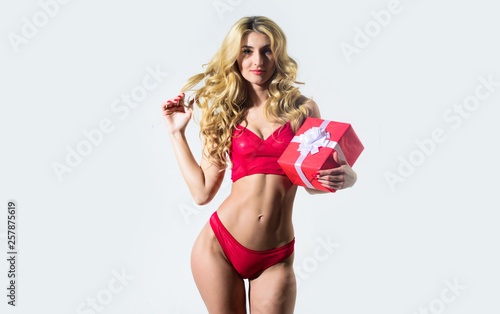 fototapeta na ścianę Erotic gift. Girl slim sexy fashion model curly hairstyle. Woman wear sexy erotic lingerie. Sexy underclothing fashion. Seductive sexy woman in lingerie. Fashionable female red bra and panties