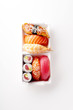Creative layout with various sushi on white background. Shrimp, eel, salmon and tuna