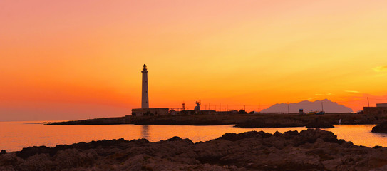 beautiful romantic colorful Sunset on Favignana's lighthouse - Punta sottile, Favignana - Sicily Italy