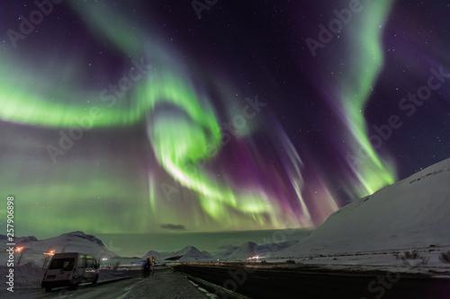 Aurora borealis with snow mountains. © Thanut
