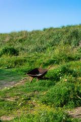 Old Wheelbarrow on a Green Hill © James