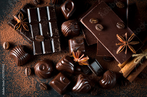 fototapeta na ścianę Assortment of dark, white and milk chocolate stack, chips. Chocolate and coffee beans on rustic wooden sacking background. Spices, cinnamon. Selective macro focus. Chocolates background. Sweets