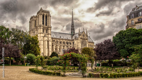 View of the Cathedral of Notre Dame de Paris from old city park before the storm. Paris, France. - 257959088