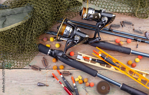 fishing tackle on a wooden table. toned image  © Karnav