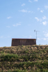 A small house on a hill on a clear day © Tom