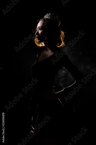 Portrait Silhouette Shadow Back Rim Light of Miss Pageant Beauty Queen Contest with Silver Diamond Crown wave hand express feeling smile, studio lighting dark black background