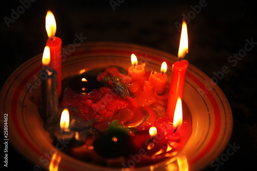 Colored candles burning in the dark © ALYEVA