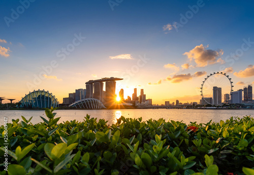 Leinwandbild Motiv Urban downtown business buildings area at sunset in Singapore.Singapore is a world famous tourist city.