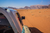 car rally tour speed fuzzy sand track in desert scenery landscape navigator concept photography