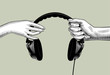 Hands of man and woman holding headphones