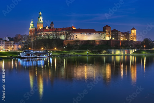 Krakow, Poland. Wawel Hill with Wawel Royal Castle and Wawel Cathedral in twilight. View from Debnicki bridge across Vistula river. © Mikhail Markovskiy