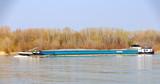 Cargo ship upstream on the river Danube
