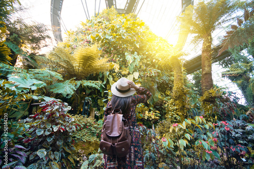 Tourist woman is traveling in the tropical forest jungle in Singapore.