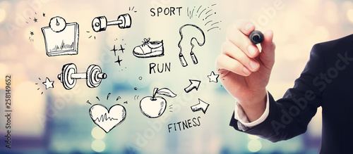 Fitness and diet with businessman on blurred abstract background © Tierney