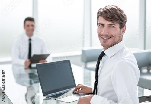 Leinwandbild Motiv rear view.successful businessman sitting at the office Desk