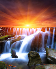 waterfall on sunset background