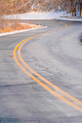 Curving road on a snowy hill in Salt Lake City © Jason
