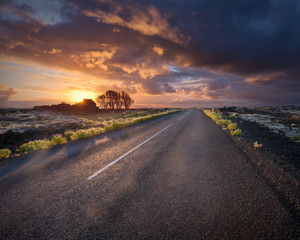 Empty road in south Iceland at sunset