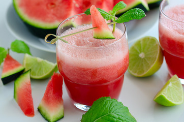 Watermelon smoothie with lemon and mint to cool down on hot days. Refreshening fruit drink for hot summer days.