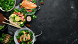 Assortment of food. Folk cuisine on a black wooden background Top view. Free space for your text. Flat lay