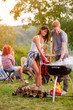 Girl and boy preparing barbecue