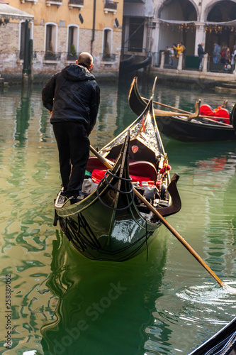 Italy, Venice, view of canals with gondolas carrying visiting tourists. © benny