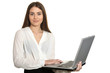 Leinwandbild Motiv Portrait of young business woman with laptop posing on white background