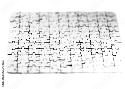 close up. blank card collected from puzzle pieces on a white sheet © yurolaitsalbert