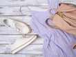 Womens clothing, shoes, accessories (lavender dress, white leather sneakers, beige backpack). Fashion outfit, spring summer collection. Shopping concept. Flat lay, view from above