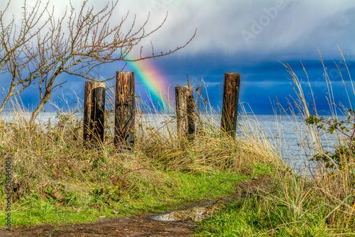 Rainbow behind posts © Kelly