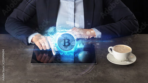 Leinwandbild Motiv Business woman working on tablet with cryptocurrency and network concept