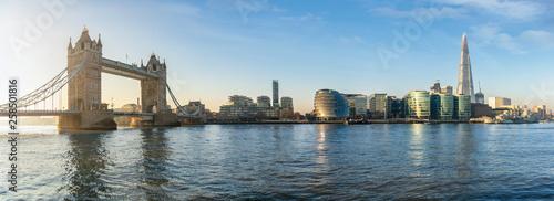 Leinwandbild Motiv The iconic urban skyline of London, UK, during a sunny morning: from the Tower Bridge to London Bridge