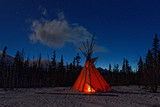 Teepee in the forest at night
