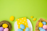 Easter holiday background with easter eggs, basket, plate, bird nest and chicks decoration.