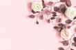 Leinwanddruck Bild - Flowers composition. Pink flowers and eucalyptus leaves on pastel pink background. Flat lay, top view, copy space
