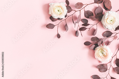 Flowers composition. Pink flowers and eucalyptus leaves on pastel pink background. Flat lay, top view, copy space - 258558832