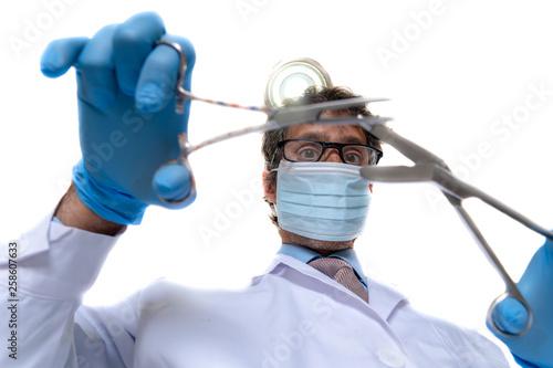 fototapeta na ścianę doctor operating white isolated background