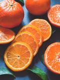 Fresh orange mandarin satsuma tangerine on the grey background -  slate background, flat lay, top view position.